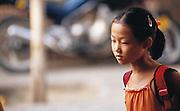 Young schoolgirl walking home in Yinchuan. Ningxia Province, China.