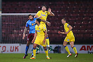 AFC Wimbledon defender Will Nightingale (5) heads clear  during the EFL Sky Bet League 1 match between Scunthorpe United and AFC Wimbledon at Glanford Park, Scunthorpe, England on 28 February 2017. Photo by Simon Davies.
