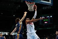 SPAIN, Madrid: Real Madrid's Greek player Ioannis Bourousis and Ucam Murcia´s Montenegrin player Nemanja Radovic during the Liga Endesa Basket 2014/15 match between Real Madrid and Ucam Murcia, at Palacio de los Deportes in Madrid on November 16, 2014.