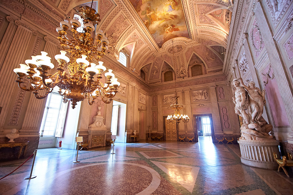"""""""The Room of the Bodyguards"""" - the second antechamber is also called the """"Room of Stuccoes"""" for its rich decoration. On the walls are 12 bas-reliefs made between 1786 and 1789 depicting scenes from the second Punic War. To the Right is a statue of Alessandro Farnese dressed as a Roman commander being crowned for the victory over the people of Flanders and returning them to Roman Catholisism. The statue is by Simone Moschino.The Bourbon Kings of Naples Royal Palace of Caserta, Italy. .<br /> <br /> Visit our ITALY HISTORIC PLACES PHOTO COLLECTION for more   photos of Italy to download or buy as prints https://funkystock.photoshelter.com/gallery-collection/2b-Pictures-Images-of-Italy-Photos-of-Italian-Historic-Landmark-Sites/C0000qxA2zGFjd_k<br /> <br /> <br /> Visit our EARLY MODERN ERA HISTORICAL PLACES PHOTO COLLECTIONS for more photos to buy as wall art prints https://funkystock.photoshelter.com/gallery-collection/Modern-Era-Historic-Places-Art-Artefact-Antiquities-Picture-Images-of/C00002pOjgcLacqI"""