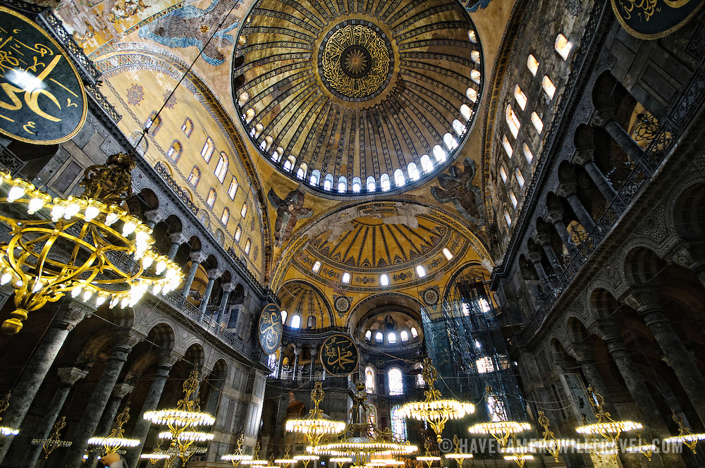 The main, central dome and chandeliers in Hagia Sophia in Istanbul, Turkey. Originally built as a Christian cathedral, then converted to a Muslim mosque in the 15th century, and now a museum (since 1935), the Hagia Sophia is one of the oldest and grandest buildings in Istanbul. For a thousand years, it was the largest cathedral in the world and is regarded as the crowning achievement of Byzantine architecture.