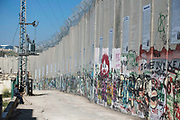 The partition wall which annexes Palestinian land to Israel on 1st April 2016 in Bethlehem, West Bank. During the Palestine Marathon, thousands of runners, both professional and amateur come from across the globe to take part in the Right to Movement event.