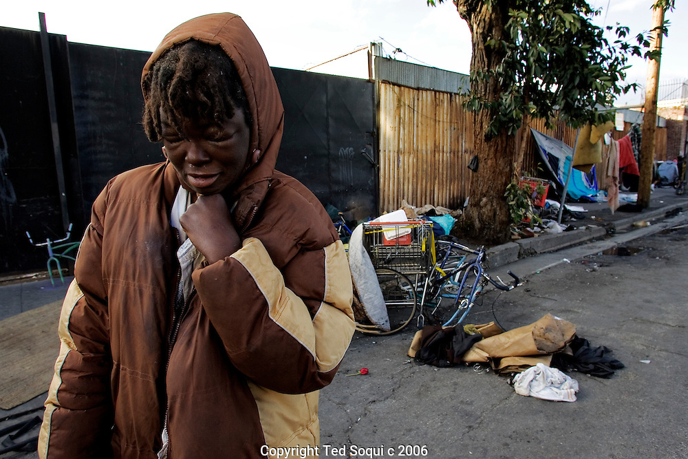 A young homeless women standing on the street in Downtown LA's skid row.
