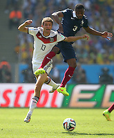 Thomas Muller of Germany and Patrice Evra of France