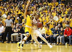 Jan 20, 2018; Morgantown, WV, USA; Texas Longhorns guard Matt Coleman (2) drives to the basket while guarded by West Virginia Mountaineers guard James Bolden (3) during the first half at WVU Coliseum. Mandatory Credit: Ben Queen-USA TODAY Sports