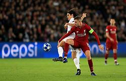 Paris Saint-Germain's Edinson Cavani (left) and Liverpool's Jordan Henderson battle for the ball during the UEFA Champions League, Group C match at the Parc des Princes, Paris.