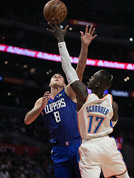 October 19, 2018 - Los Angeles, California, U.S - Danilo Gallinari #8 of the Los Angeles Clippers tries to block Dennis Schroder #17 of the Oklahoma Thunder during their NBA game on Friday October 19, 2018 at the Staples Center in Los Angeles, California. Clippers defeat Thunder, 108-92. (Credit Image: © Prensa Internacional via ZUMA Wire)
