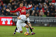Borja Baston of Swansea city is fouled by Marcos Rojo of Manchester Utd ..Premier league match, Swansea city v Manchester Utd at the Liberty Stadium in Swansea, South Wales on Sunday 6th November 2016.<br /> pic by  Andrew Orchard, Andrew Orchard sports photography.