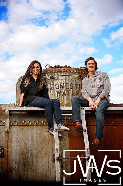 Two siblings posing on top of a train in Grapevine.