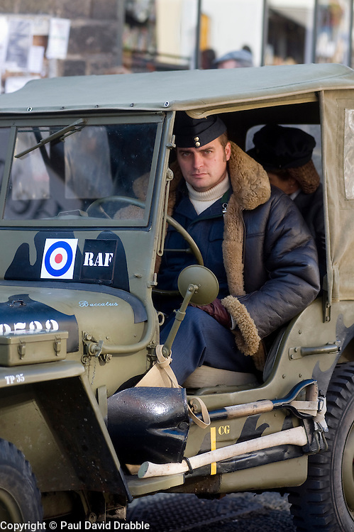 A reenactor dressed as a member of the Royal Air Force (RAF) sits behind the wheel of an RAF marked Willys Jeep at the Pickering 1940s war weekend 16th-18th October 2009 Image Copyright Paul David Drabble