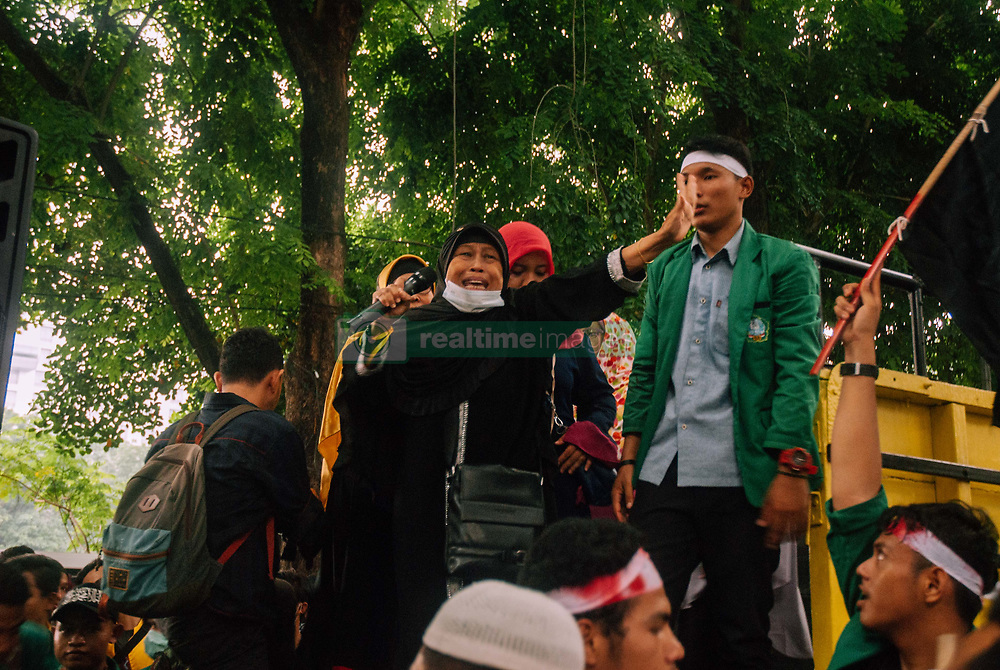 May 24, 2019 - Medan - North Sumatera, Indonesia - The masses who acted in the name of the National Sovereignty Movement (GNKR) again held a demonstration related to the results of the 2019 Presidential Election recapitulation. They considered the 2019 Election implementation to be fraudulent and far from democratic values..This time, the concentration of thousands of demonstrators was centered at the North Sumatra Regional Parliament (DPRD) Office on Friday (05/24/2019)..This action is a continuation of the previous demonstration at the Office of the General Election Commission (KPU) on Tuesday (5/21/2019). Then at the office of the North Sumatra Election Supervisory Agency (Bawaslu) on Wednesday (5/22/2019)..In addition to speeches and peaceful actions, the masses also held congregational prayers in front of the North Sumatra Regional Parliament (DPRD) building. (Credit Image: © Sabirin Manurung/Pacific Press via ZUMA Wire)
