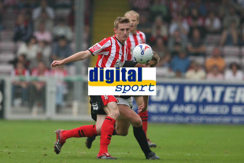 Photo: Pete Lorence.<br />Lincoln City v Milton Keynes Dons. Coca Cola League 2. 16/09/2006.<br />Jeff Hughes of Lincoln and Gareth Edds in action.