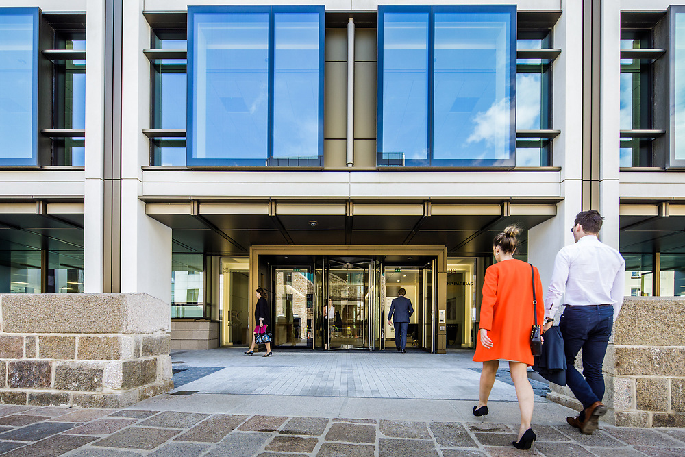Businessman and woman walking into the International Finance Centre in St Helier, Jersey