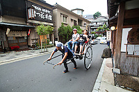 """Rickshaw at Hakone Taki-Dori or """"Waterfall Street"""" - the main drag of hot spring spa resorts in Hakone, for which the town is famous besides its access to hiking, boating and Mt Fuji views."""