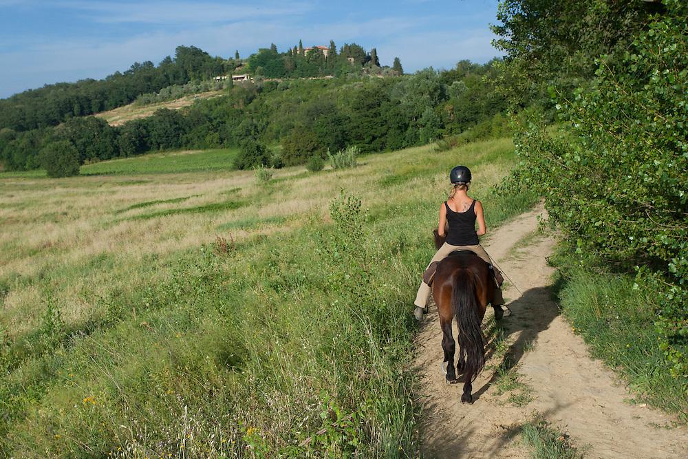 Europe, Italy, Tuscany, Volterra, woman horseback riding on Icelandic Pony