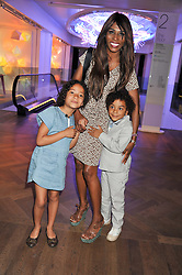 SINITTA with her children MAGDALENA and ZAC at a tea party to celebrate the launch of the limited edition Heart & Sole shoe collection by Step2wo in aid of the British Heart Foundation's Mending Broken Hearts Appeal, held at Aubaine on 2, Selfridge's, Oxford Street, London on 4th July 2012.