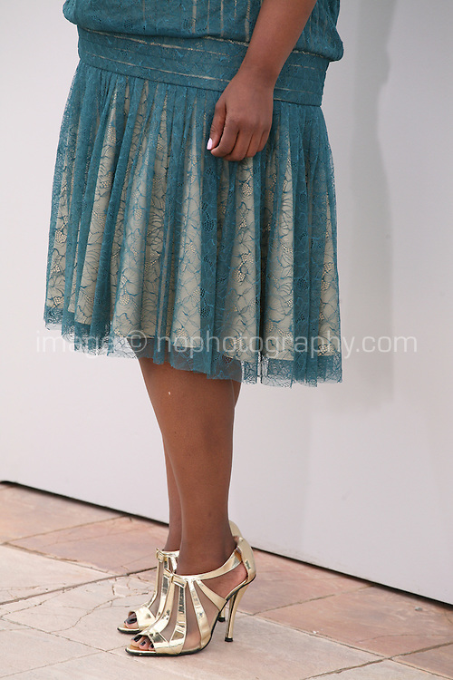 Octavia Spencer, actress, wearing gold high heeled sandals  at the Fruitvale Station film photocall at the Cannes Film Festival 16th May 2013