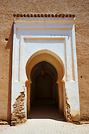 Arabesque arch to the inner courtyard of the  Alaouite Ksar Fida built by Moulay Ismaïl the second ruler of the Moroccan Alaouite dynasty ( reigned 1672–1727 ). Residence of the Khalifa or Caid of Tafilalet until 1965. Tafilalet Oasis, near Rissini, Morocco .<br /> <br /> Visit our MOROCCO HISTORIC PLAXES PHOTO COLLECTIONS for more   photos  to download or buy as prints https://funkystock.photoshelter.com/gallery-collection/Morocco-Pictures-Photos-and-Images/C0000ds6t1_cvhPo<br /> .<br /> <br /> Visit our ISLAMIC HISTORICAL PLACES PHOTO COLLECTIONS for more photos to download or buy as wall art prints https://funkystock.photoshelter.com/gallery-collection/Islam-Islamic-Historic-Places-Architecture-Pictures-Images-of/C0000n7SGOHt9XWI