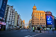 Callao Square and Gran Via Street during the confinement due to the national emergency caused by Covid-19 on April 12, 2020 in Madrid, Spain  <br /> The day before workers on Spain they return theirs non-essential works