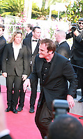 Quentin Tarantino dancing on the red carpet at Sils Maria gala screening at the 67th Cannes Film Festival France. Friday 23rd May 2014 in Cannes Film Festival, France.