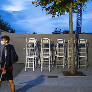 PARIS, FRANCE October 08. Spare umpires chairs as a ball boys leaves the stadium at the end of the day during the French Open Tennis Tournament at Roland Garros on October 8th 2020 in Paris, France. (Photo by Tim Clayton/Corbis via Getty Images)