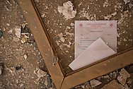 A blank marriage certificate lies on the ground of a ransacked church office in Qaraqosh, Iraq. ISIS occupied this predominately Christian town from 2014 to 2016. (May 20, 2017)