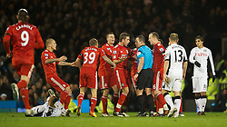 05.12.2011, Craven Cottage Stadion, London, ENG, PL, FC Fulham vs FC Liverpool, 14. Spieltag, im Bild Liverpool players surround the referee Kevin Friend after he sent off Jay Spearing during the football match of English premier league, 14th round, between FC Fulham and FC Liverpool at Craven Cottage Stadium, London, United Kingdom on 05/12/2011. EXPA Pictures © 2011, PhotoCredit: EXPA/ Sportida/ David Rawcliff..***** ATTENTION - OUT OF ENG, GBR, UK *****
