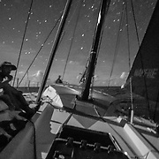 Leg 4, Melbourne to Hong Kong, day 08 on board MAPFRE, Night shot, Blair Tuke at the bow looking around. Photo by Ugo Fonolla/Volvo Ocean Race. 08 January, 2018.