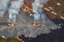 2018 05 24 - Pahoa, Hawaii, USA:  Fissure 7 reactivated with vigorous fountaining, sending flows through Leilani Estates once again, consuming several homes and property.<br />Photo: ZUMA/Bruce Omori/Paradise Helicopters