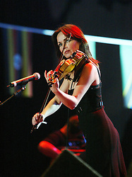 Sharon Corr performs on stage..50,000 people filed into Murrayfield Stadium in Edinburgh, Scotland, on Wednesday July 6, 2005. The free gig, labelled Edinburgh 50,000 - The Final Push was the last of Bob Geldof's momentous Live 8 concerts..Pic ©2010 Michael Schofield. All Rights Reserved.