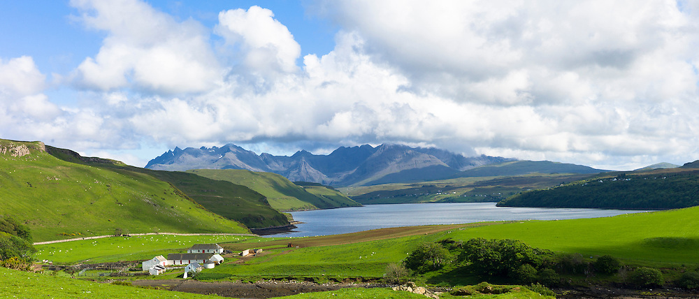 The Cuillin mountain range with croft farm and Loch Harport near Coillure on Isle of Skye in the Highlands and Islands of Scotland