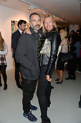 HARDY BLECHMAN head designer of Maharishi and TIGGY KENNEDY at a private view of an exhibition of paintings by Billy Zane entitled 'Save The Day Bed' held at the Rook & Raven Gallery, Rathbone Place, London on 10th October 2013.