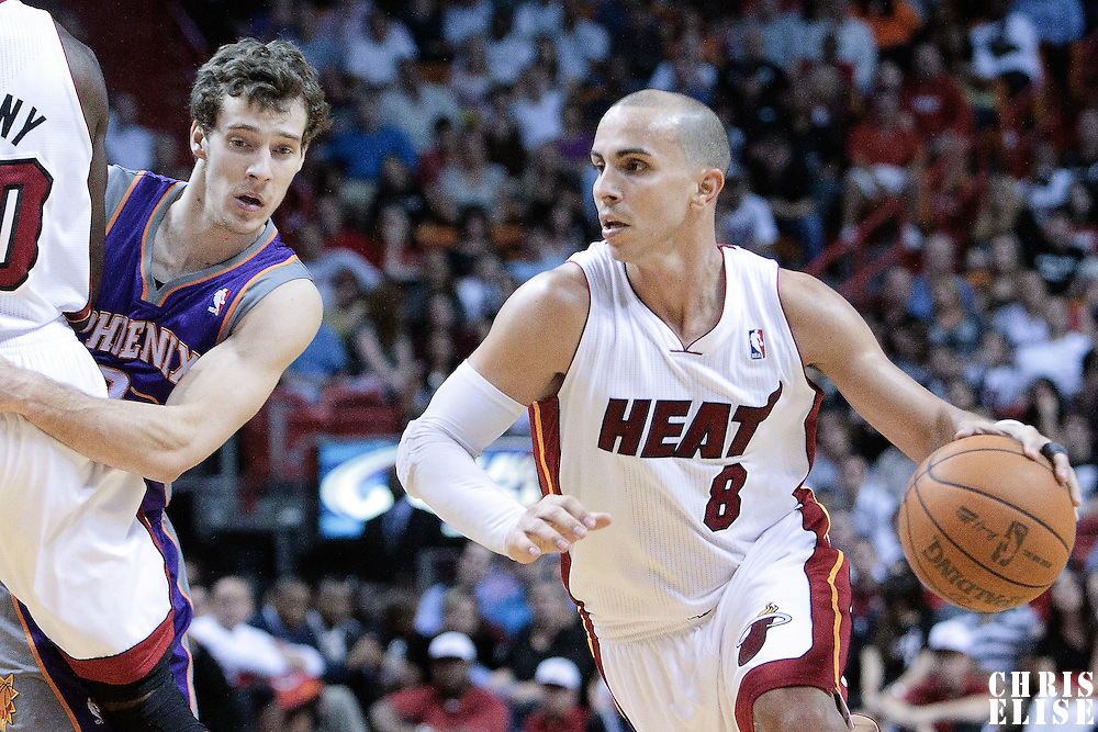 17 November 2010: Miami Heat's point guard #8 Carlos Arroyo drives past Phoenix Suns' point guard #2 Goran Dragic during the Miami Heat 123-96 victory over the Phoenix Suns at the AmericanAirlines Arena, Miami, Florida, USA.