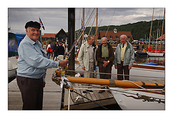 The last remeining workers from the Fife Yard next to the dragon of Clio. ...This the largest gathering of classic yachts designed by William Fife returned to their birth place on the Clyde to participate in the 2nd Fife Regatta. 22 Yachts from around the world participated in the event which honoured the skills of Yacht Designer Wm Fife, and his yard in Fairlie, Scotland...FAO Picture Desk..Marc Turner / PFM Pictures
