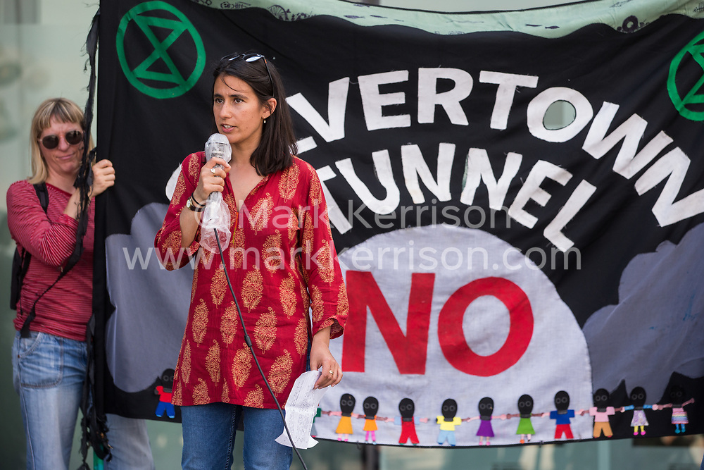 London, UK. 5th June, 2021. Ruth Fitzharris of Mums for Lungs addresses environmental activists and local residents protesting against the construction of the Silvertown Tunnel. Campaigners opposed to the controversial new £2bn road link across the River Thames from the Tidal Basin Roundabout in Silvertown to Greenwich Peninsula argue that it is incompatible with the UK's climate change commitments because it will attract more traffic and so also increased congestion and air pollution to London's most polluted borough.