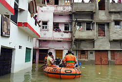 GAYA, Sept. 7, 2016 (Xinhua) -- Rescue personnel ferry residents besieged by flood in Gaya District, north Indian state of Bihar, Sept. 7, 2016. Rescues were operated by State Disaster Response Fund Wednesday among continuous flood in Gaya. Flood situation in this area appeared to be easing with the water level of swollen Ganga flowing below the danger mark, reported local media. (Xinhua/Stringer).****Authorized by ytfs* (Credit Image: © Xinhua via ZUMA Wire)