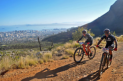 CAPE TOWN, SOUTH AFRICA - MARCH 18: Colombians Luz Gonzalez and Yonatten Florez ascend Platteklip during the 20km prologue at UCT on Table Mountain on March 18, 2018 in Cape Town, South Africa. Mountain bikers from across South Africa and internationally gather to compete in the 2018 ABSA Cape Epic, racing 8 days and 658km across the Western Cape with an accumulated 13 530m of climbing ascent, often referred to as the 'untamed race' the Cape Epic is said to be the toughest mountain bike event in the world. (Photo by Dino Lloyd)