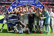 The Millwall squad celebrating promotion with the League 1 Play off trophy. EFL Skybet football league one play off final match, Bradford city v Millwall at Wembley Stadium in London on Saturday 20th May 2017.<br /> pic by Steffan Bowen,  Andrew Orchard sports photography.