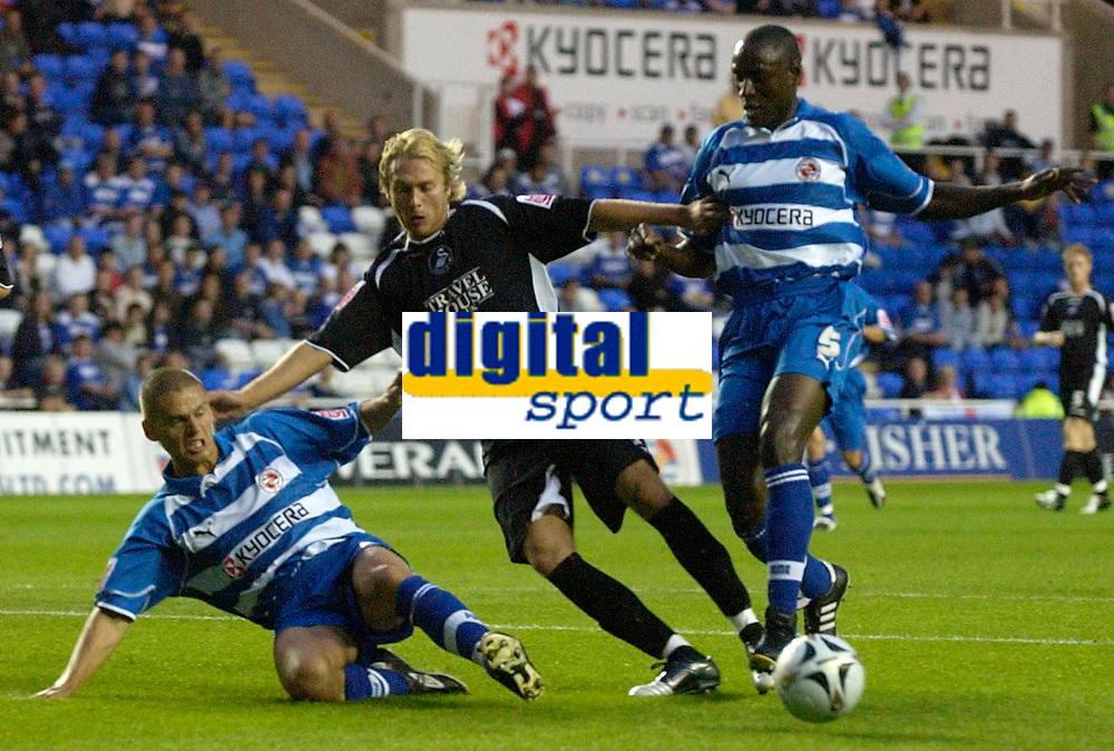 Photo: Daniel Hambury.<br /> Reading v Swansea. Carling Cup.<br /> 23/08/2005.<br /> Reading's Ivar Ingimarsson and Ibrahima Sonko combine to stop Swansea's Paul Conner.