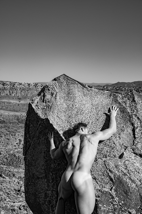 male nude against a rock