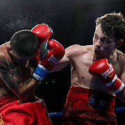Michael Gaxiola (L) fights Daniil Platonovschi during a One For All Promotions boxing event at the Caribe Royale Orlando Events Center on Saturday, February 20, 2021 in Orlando, Florida. (Alex Menendez via AP)