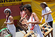 Drummers in the street outside a church. Often the lines between Candomble and Catholicism are blurred. This is especially true with the Sao Lazaro event in late January in Salvador, Bahia, Brazil, the city which is known as the home of Candomble. Sao Lazaro represents healing and the sick.