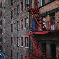 Girl on fire escape along the Highline Park
