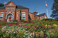 Beautiful gardens adorn the front lawn of the Meredith Public Library.  (Karen Bobotas/for the Laconia Daily Sun)