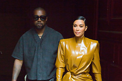 """File photo of Kanye West and Kim Kardashian with Balenciaga bag leaving Kanye West Sunday service at Des Bouffes du Nord Theater during Women fashion week Fall/Winter 2020-2021 in Paris on March 01, 2020. Kim Kardashian West spoke out about Kanye West's bipolar disorder Wednesday, three days after the rapper delivered a lengthy monologue at a campaign event touching on topics from abortion to Harriet Tubman, and after he said he has been trying to divorce her.Kardashian West said in a statement posted in an Instagram Story that she has never spoken publicly about how West's bipolar disorder has affected their family because she is very protective of their children and her husband's """"right to privacy when it comes to his health."""" Photo by Nasser Berzane/ABACAPRESS.COM"""