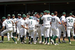 22 April 2006:  ....Titan pinch runner Mike Ally gets a round of good jobs from his team mates after scoring the 2nd titan run.....In CCIW, Division 3 action, the Titans of Illinois Wesleyan capped the Auggies of Augustana College by a scor of 3-2 in game one of a double card afternoon.  Games were held at Jack Horenberger field on the campus of Illinois Wesleyan University in Bloomington, Illinois