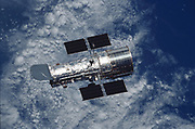 The Hubble Space Telescope floats against the background of Earth after a week of repair and upgrade by Space Shuttle Columbia astronauts in 2002