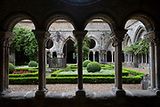 Cloister at Fontfroide Abbey near Narbonne, France. Fontfroide Abbey is a former Cistercian monastery in France, situated 15 kilometers south-west of Narbonne. It was founded in 1093 by Aimery I, Viscount of Narbonne, but remained poor and obscure, and needed to be refounded by Ermengarde, Viscountess of Narbonne. The abbey fought together with Pope Innocent III against the heretical doctrine of the Cathars who lived in the region. It was dissolved in 1791 in the course of the French Revolution. The premises, which are of very great architectural interest, passed into private hands in 1908, when the artists Gustave and Madeleine Fayet dAndoque bought it to protect the fabric of the buildings from an American collector of sculpture. They restored it over a number of years and used it as a centre for artistic projects. It still remains in private hands. Today it is open to paying guests.