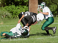 Middletown, NY - Two Minisink Valley defenders try to tackle a Middletown player during an Orange County Youth Football League game at Watts Park on Sept. 2, 2007.