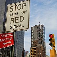 Confusing traffic signs contradict each other at the corner of First Avenue and 48th Steet in New York City.